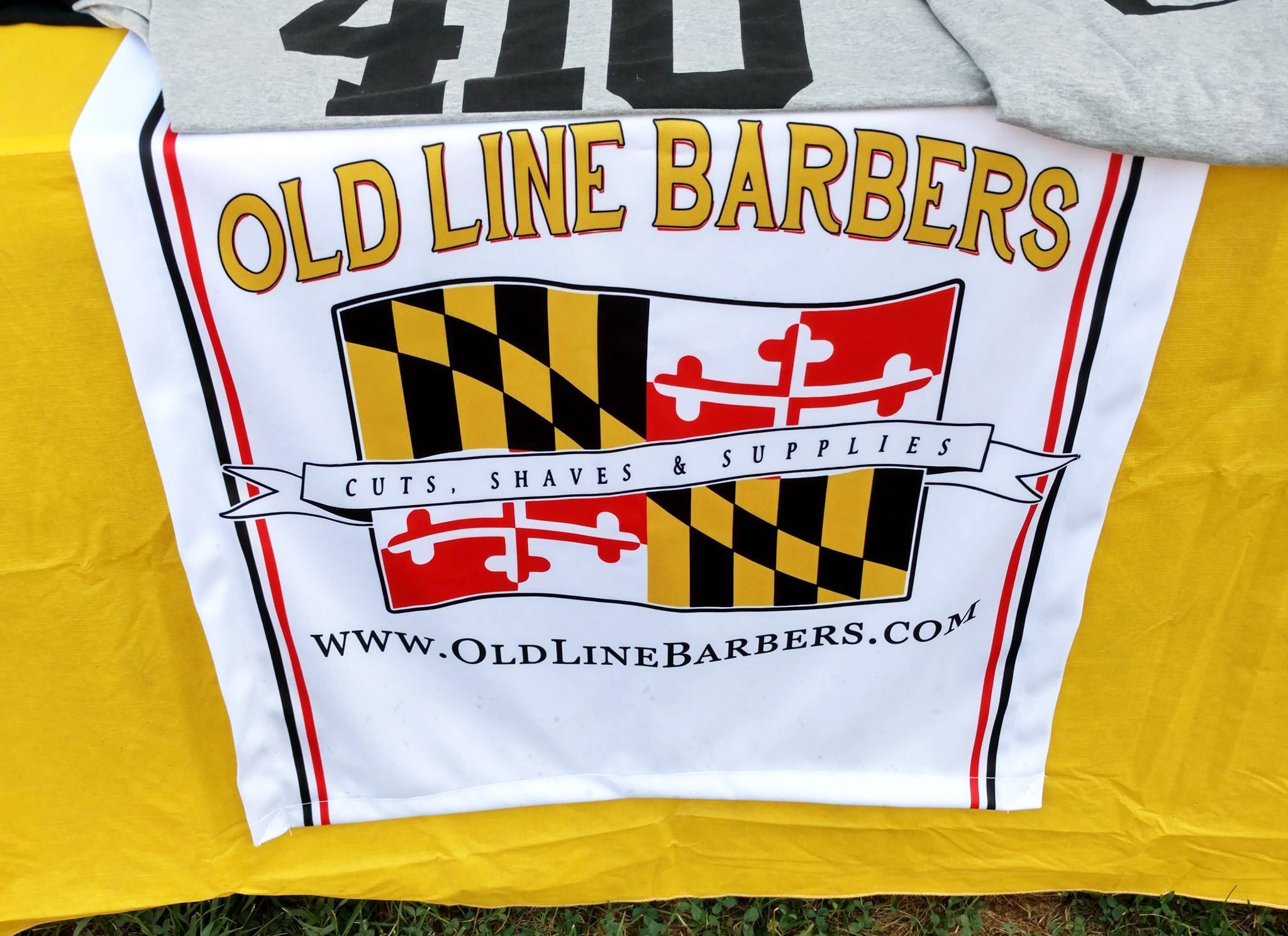 Custom designed table runner for vendor events. Made specially for Old Line Barbers.